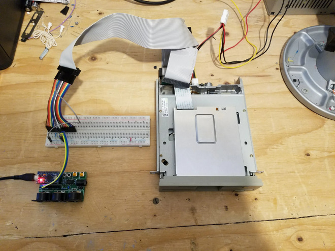 The final product: a 5.25 inch floppy connected by a ribbon cable to an Arduino